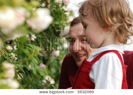 Little Girl, Her Father And Flowers