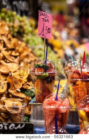 Variety Of Fruit Salad In La Boqueria Market In Barcelona.