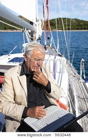 Businessman Working On Sailboat.