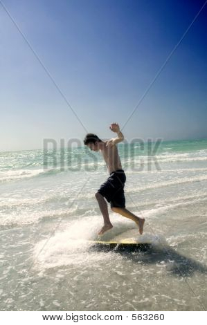 Teenage Boy Skim Boarding