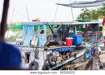 Vietnamese people in their houseboat at Mekong Delta