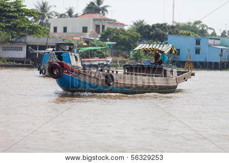 Vietnamese men on the boat in Mekong Delta