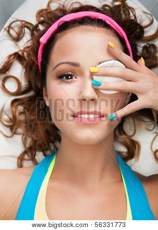 Make up removal concept, woman with cotton pad