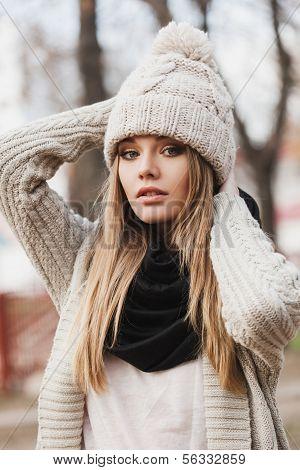 Fashionable Stylish Girl In White Knit Jacket