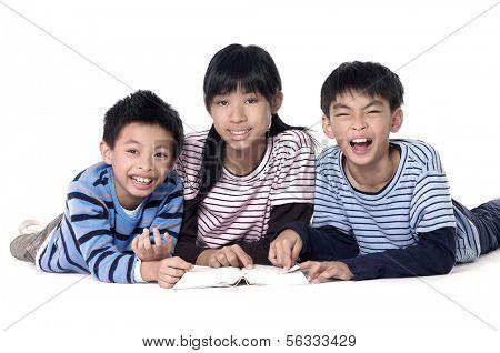 Three kids lying on floor. Isolated on white.