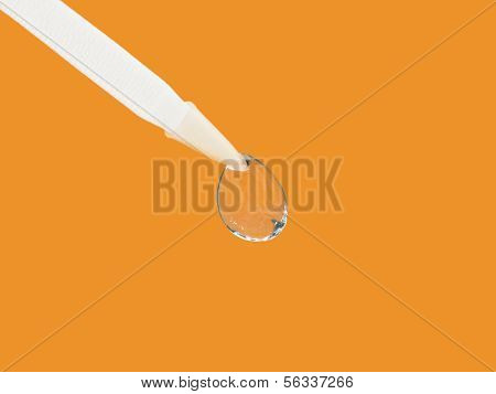 Contact lens on an orange background