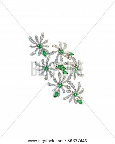 golden brooch with diamonds and emeralds