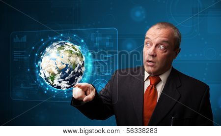 Businessman standing and touching high-tech 3d earth panel, Elements of this image furnished by NASA