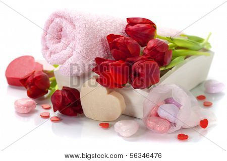 Bath and spa Valentine theme with towel, bath soaps and tulips
