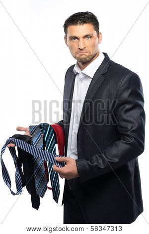 Bewildered handsome man in black suit and choice of ties
