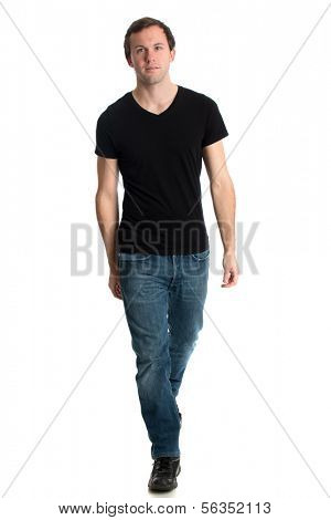 Young man in jeans and a black tee shirt. Studio shot over white.