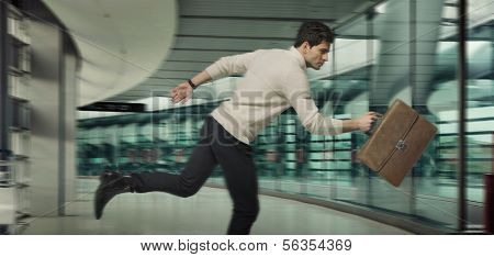 Young running businessman