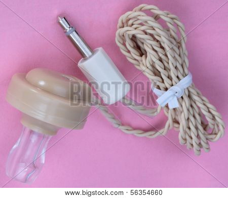 Plastic Headphones On Pink Background