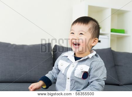 Asian little boy giggle
