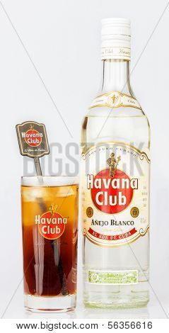HAVANA,CUBA -?? DECEMBER 25,2013:Havana Club rum bottle and a glass containing a Cuba Libre.Established in 1878 in Santa Cruz del Norte in Cuba, Havana Club is the world's No.3 international rum brand