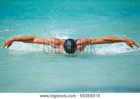 young man swimming in oceans water
