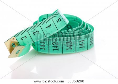 Close-up of a green measuring tape, symbol of accuracy, handicrafts or weight loss, on white background