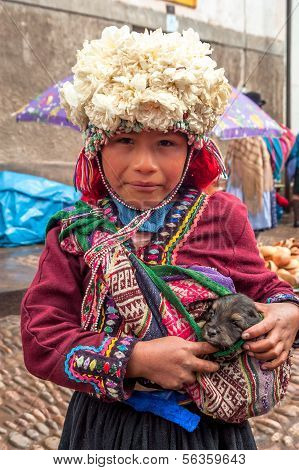 Girl with a small dog in Pisac
