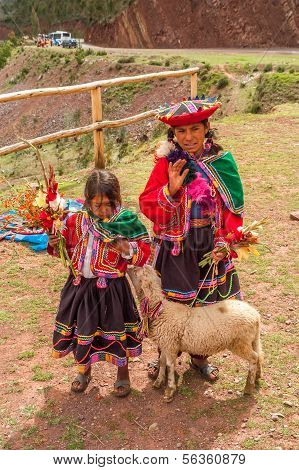 Girls With Lama And Flowers