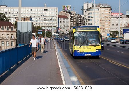 BELGRADE, SERBIA - AUG 15: Pedestrians and bus on Stari Savski bridge on August 15, 2012 in Belgrade, Serbia. City public transport consists of buses, trams, and trolley buses.