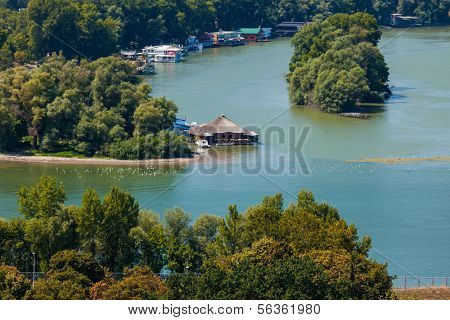 BELGRADE, SERBIA - AUG 15: Aerial view of houseboats on Ada Ciganlija on August 15, 2012 in Belgrade, Serbia. Houseboats are very popular nightlife destination.