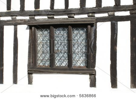 Window of Tudor-style house