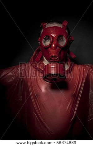 Apocalypse, A man in a gas mask over  the smoke. black background and red colors