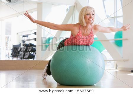 Woman Balancing On Swiss Ball