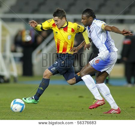 BARCELONA - DEC, 30: Catalan player Bojan Krkic(L) vies with Mario Soares(R)  during the friendly match between Catalonia and Cape Verde at Olympic Stadium on December 30, 2013 in Barcelona, Spain