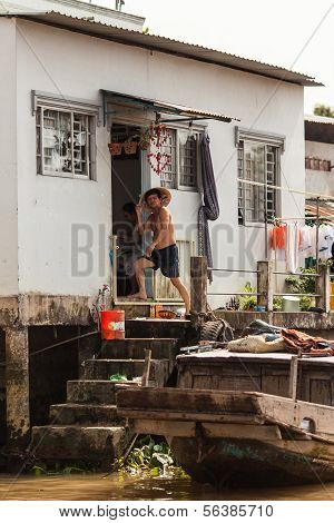 Vietnamese people at their house in Mekong Delta