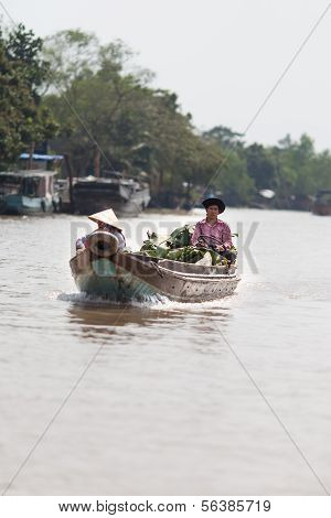 Vietnamese people on the way to the market at Mekong delta