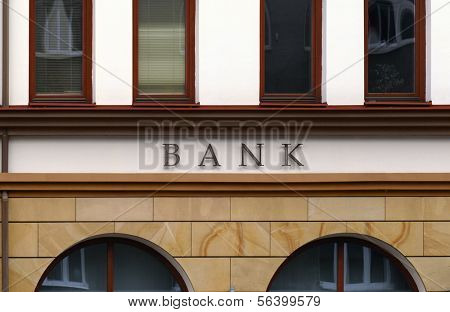 Small branch bank facade detail. No logo, only BANK letters.