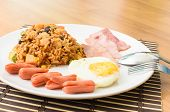 foto of yoke  - American fried rice with pork sausage bacon and fried egg - JPG