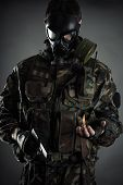 image of bio-hazard  - soldier with mask honors the memory fallen comrades - JPG