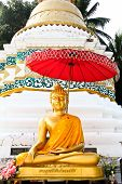stock photo of chums  - Golden buddha image in front of pagoda ia Wat Sri Chum - JPG
