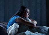 stock photo of suffering  - Portrait of a young woman suffering from insomnia - JPG