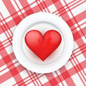 Background white plate with realistic heart.