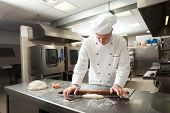 foto of pastry chef  - Chef preparing pastry in his kitchen - JPG