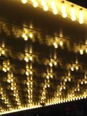 image of marquee  - Looking up at an overhand with halogen marquee lights - JPG