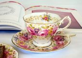 stock photo of tea party  - Flowered cup and saucer with side plate and cake - JPG