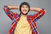 stock photo of beanie hat  - Stylish young man in shirt and beanie hat - JPG