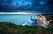 stock photo of atlantic ocean beach  - storm over cliffs in Atlantic ocean Etretat France - JPG