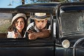 picture of tommy-gun  - 1920s vintage gangsters firing guns from car window - JPG
