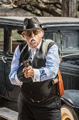 pic of tommy-gun  - Dangerous male gangster with cigar firing machine gun