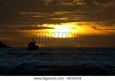 Fisherboat At Sunset