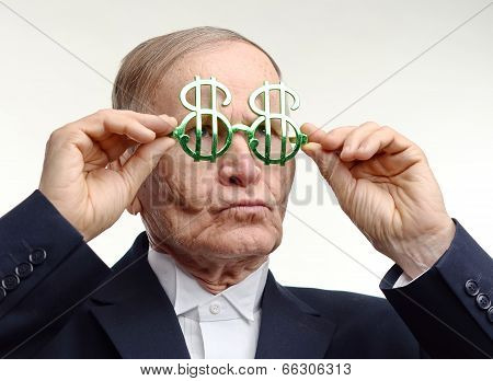 Man with dollar sign glasses