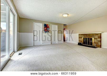 Empty Room With Fireplace And Walkout Deck