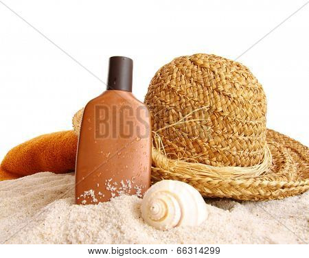 Straw hat with towel and suntan lotion on white background