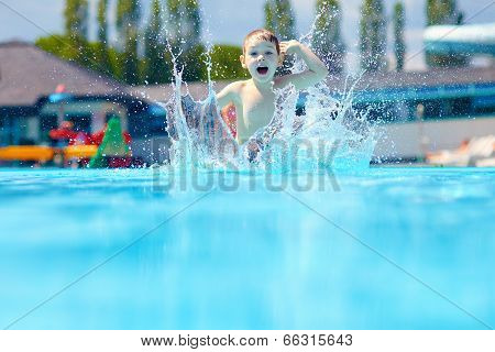 Happy Boy Kid Jumping In The Pool