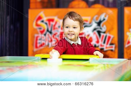 Happy Child Playing Table Air Hockey